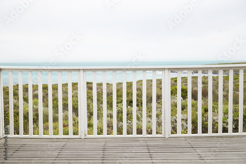 Wooden decking at railing at resort Fototapet