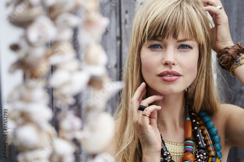 Fotografering  Beautiful young blond woman wearing boho necklace, portrait