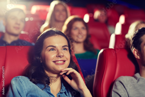 Fototapeta happy friends watching movie in theater obraz