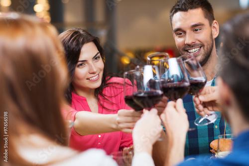 Fotobehang Restaurant friends clinking glasses of wine at restaurant