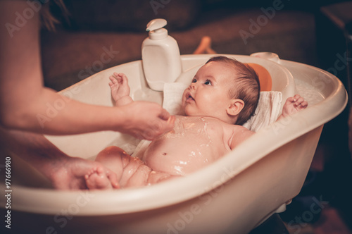 Fotografia Small baby first bathing