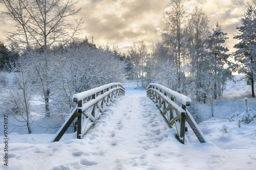 Poster Snowy, wooden bridge in a winter day. Stare Juchy, Poland.