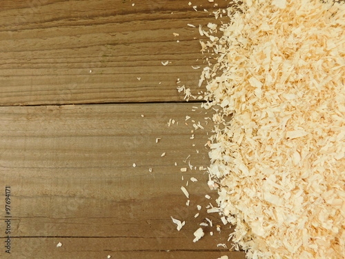 Valokuvatapetti sawdust on wooden base