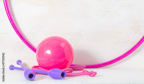 gymnastic equipment. Skipping rope, clubs for rhythmic gymnastics, hoop and ball on white background