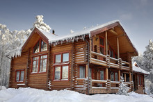 Log Home Winter With Large Win...