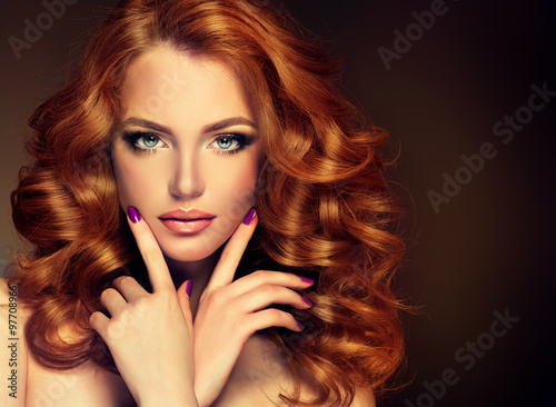Girl model with long red wavy hair. Big curls on the red head . Hairstyle  permanent waving - 97708966