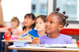 Happy children in a multi ethnic elementary classroom - 97724364
