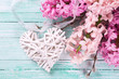 Postcard with fresh pink hyacinths and decorative heart