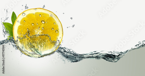 Lemon and water splashes. Wallpaper Mural