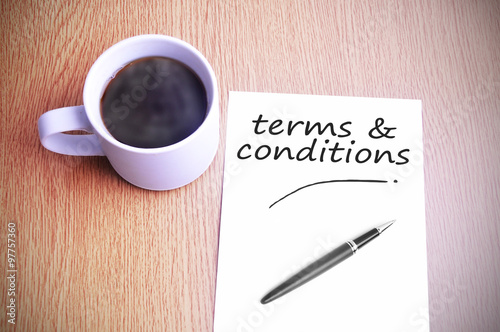Coffee on the table with note writing writing terms & conditions ...