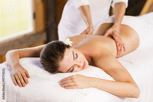 Woman enjoying massage. Billede på lærred