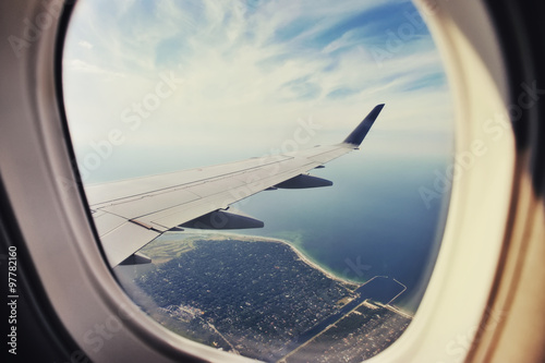 Looking through window aircraft, landing to Copenhagen airport Kastrup. - 97782160