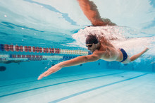 Professional Man Swimmer Inside Swimming Pool.
