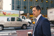 Businessman with cup of coffee in Manhattan on the street. New York.