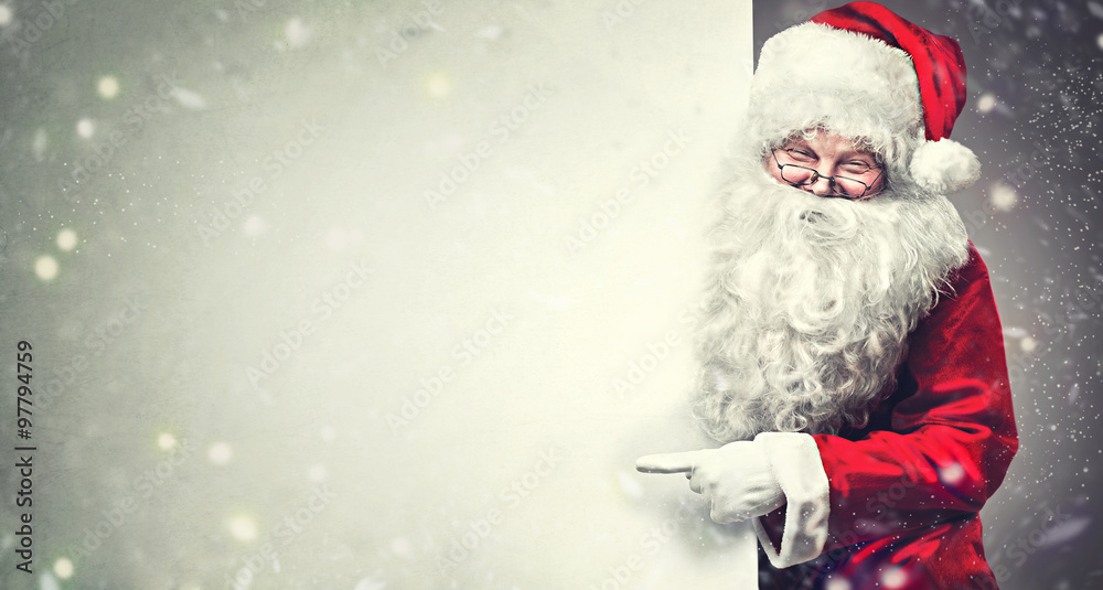 Fototapety, obrazy: Smiling Santa Claus pointing on blank advertisement banner background with copy space