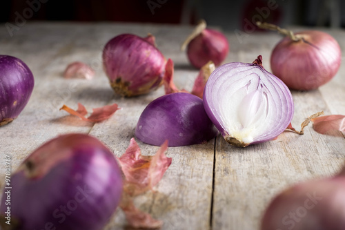 Shallot onions in a group on wood,still life