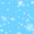 Snow fall. Blurred falling snow on the blue background