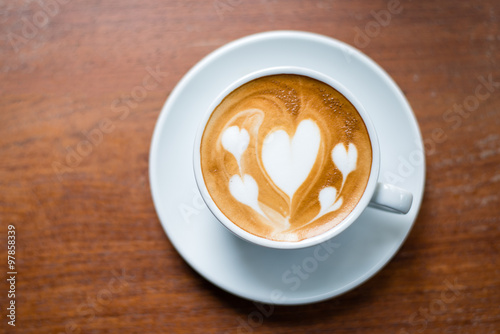 Foto op Plexiglas Chocolade Latte Art on Wooden Background
