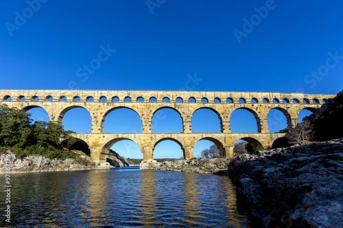 Staande foto Artistiek mon. Pont du Gard is an old Roman aqueduct near Nimes