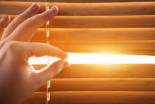 Looking Through Window Blinds, Sun Light Coming Inside.