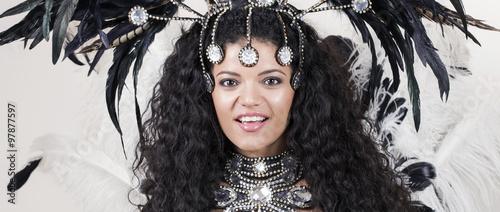 Montage in der Fensternische Karneval Happy and beautiful samba dancer wearing traditional black costu