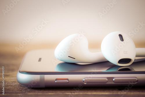 Fényképezés  closeup modern headphone on phone media portable