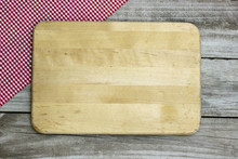 Blank Cutting Board With Napkin Border On Wood Background