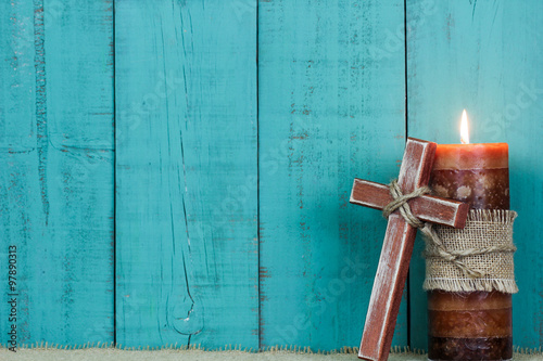 Fotografie, Obraz  Candle and wooden cross by teal blue wood background