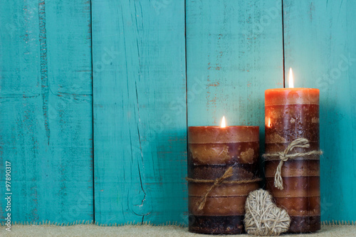 Fotografie, Obraz  Candles by rope heart and rustic wood background