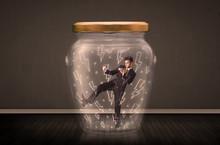 Businessman Inside A Glass Jar...