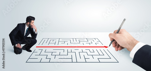 Obraz Business man looking at hand drawing solution for maze - fototapety do salonu