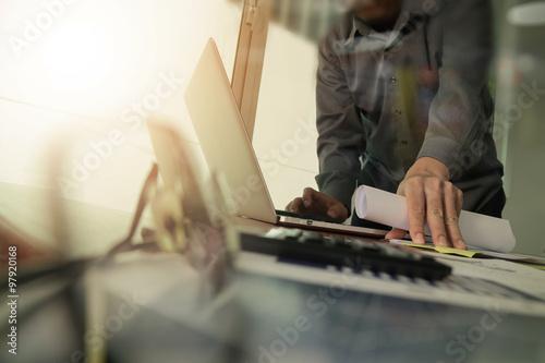 Fototapeta businessman hand working with new modern computer and smart phon obraz na płótnie