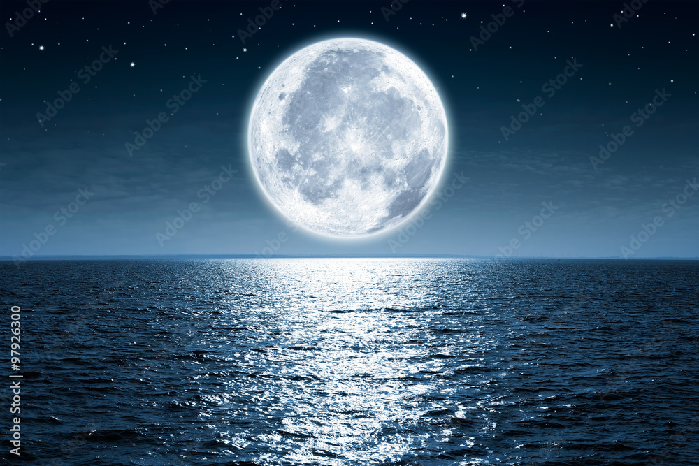 Fototapety, obrazy: Full moon rising over empty ocean at night with copy space