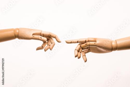 Fotografía  Two-handed wooden parody the birth of Adam by Michelangelo