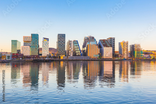 Modern buildings in Oslo with their reflection into the water Canvas Print
