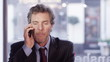 Angry businessman has a heated conversation with someone on the phone
