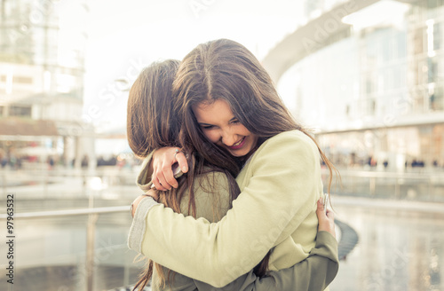 Fotografie, Obraz  Two girls hugging each others after long time they have been dis