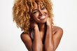 Leinwanddruck Bild - young black woman with blond curly hair