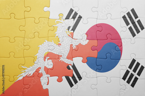 puzzle with the national flag of bhutan and south korea Poster