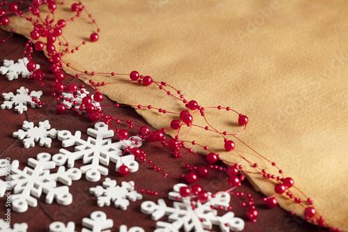 Fotobehang Macrofotografie Christmas background - snowflakes and paper sheet