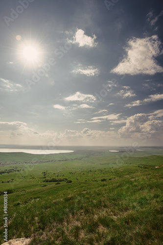 Foto op Aluminium Bleke violet Photo of beautiful landscape with grassy land under sunny skies