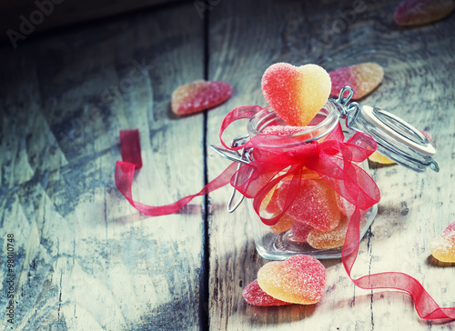 Keuken foto achterwand Snoepjes Fruit jelly pink and yellow candy hearts in a glass jar with a p