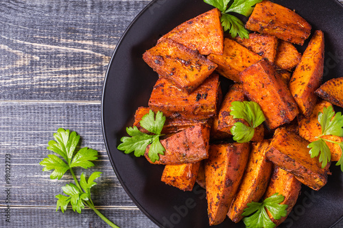 Homemade Cooked Sweet Potato with spices and herbs.