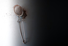 Tea Strainer With Black Tea On A Black And White Background