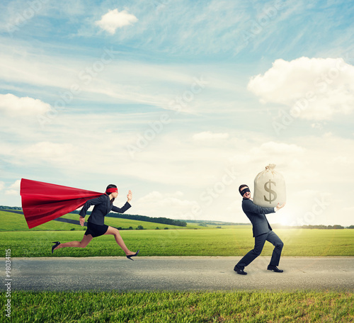 Photo  thief running away from superwoman