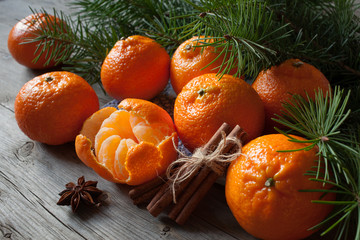 Tangerines with cinnamon and fir branches