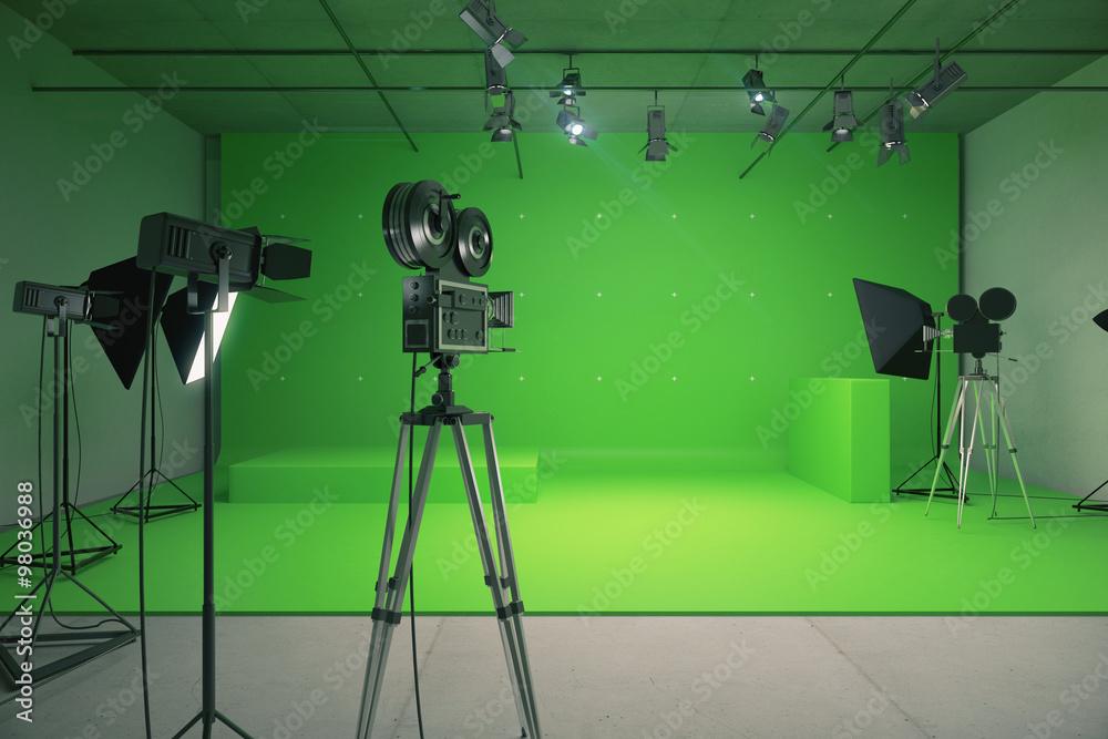 Fototapeta Modern empty green photo studio with  old style movie camera
