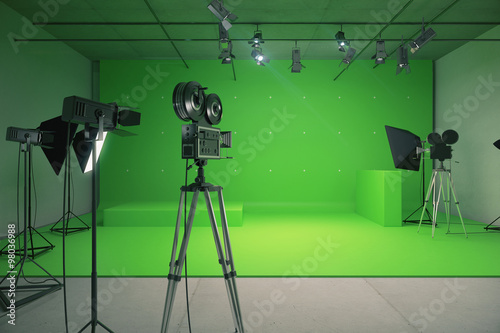 Photo  Modern empty green photo studio with  old style movie camera