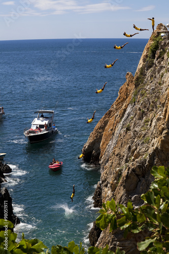 Fotografia, Obraz  Composite of the famous cliff diver of Acapulco Mexico