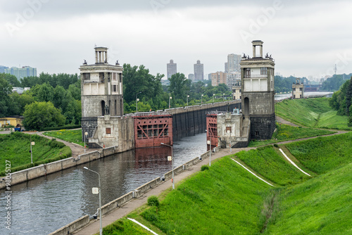 Staande foto Kanaal View on canal with open shipping lock against skyline. Moscow, Russia.